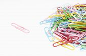 Heap of multi colored paper clips