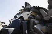 Heap of car seats in junkyard