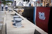 STATEN ISLAND, NY - MAY 25, 2014: The Coast Guard insignia and racing stripe on the side of the USCGC Katherine Walker (WLM 552) and mooring bollards at Sullivans Piers during Fleet Week NY.