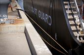 STATEN ISLAND, NY - MAY 25, 2014: Words US Coast Guard written on the side of the USCGC Katherine Wa