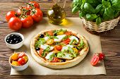 Preparing A Pizza On A Wooden Table
