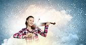 Young pretty woman in casual playing on violin