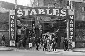 Entrance To The Stables Market In Camden Showing Shoppers Near The Entrance