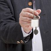 Front View Of Male Hand With Blank Door Keychain