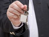 Front View Of Businessman Hand With Door Keychain