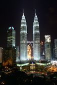 KUALA LUMPUR-APRIL 25: The Petronas Towers on April 25, 2014 in Kuala Lumpur, Malaysia. The Petronas Towers were the tallest buildings in the world for 6 years, until Taipei 101 was completed in 2004