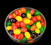 pic of jelly beans  - Fruit jelly beans in many colors in a glass bowl on a black background - JPG