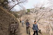 YOSHINO, JAPAN - April 17th : Tourists walking at Yoshino Mountain path Oku-Senbon, Yoshino, Nara, J
