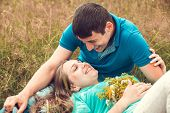 Romantic couple relaxing in field