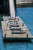 Colorful Wood Picnic Tables On A Floating Pier