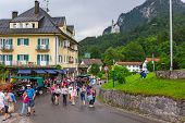 HOHENSCHWANGAU, GERMANY - 19 JUNE 2014: Tourists on the way to the Neuschwanstein Castle in Hohensch