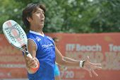 MOSCOW, RUSSIA - JULY 18, 2014: Susumu Kawashima of Japan in the match against Belgium during ITF Beach Tennis World Team Championship. Japan won 3-0