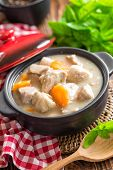 stock photo of stew  - Meat stew in a casserole on a wooden table - JPG
