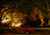 PUCHONG, MALAYSIA - JULY 26, 2014: A forest fire blazes onto the foot hills of the Air Hitam Forest