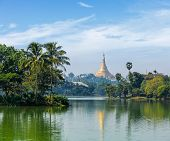 Travel Myanmar tourism background - view of  Shwedagon Pagoda over Kandawgyi Lake in Yangon, Burma (