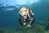 Young woman scuba diving