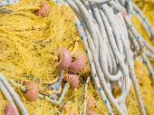 Close-up of fishing net and floats background