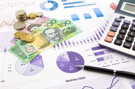 pic of budget  - australia dollar currency on financial charts expense cash flow summarizing and graphs background concepts for saving money budget management stock exchange investment and business income report - JPG