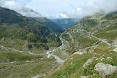 Valley And Road In Alps In Switzerland
