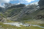 Parking In Valley And Glacier In Alps In Switzerland
