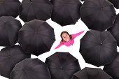 Girl Iamongst Umbrellas