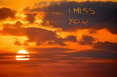 """picture of miss you  - """"i miss you"""" written at sunset in the orange sky - JPG"""
