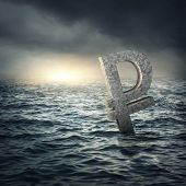 Ruble sign sinking in water.Russian economic crisis concept