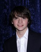 LOS ANGELES - NOV 22:  JOEL COURTNEY arrives to the