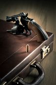 Revolver With Cylinder Open And Bullet