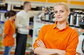 Positive seller or shop assistant portrait  in supermarket store