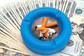 Cigarettes Ashtray And Money