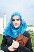 pic of hijabs  - beautiful muslim woman wearing hijab and holding holy book Koran - JPG