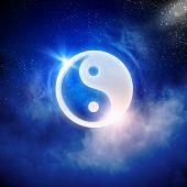Yin Yang sign in dark night sky