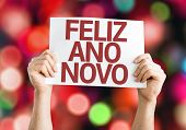 Happy New Year 2015 (In Portuguese) card with colorful background with defocused lights