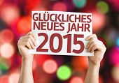 Happy New Year 2015 (In German) card with colorful background with defocused lights