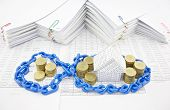 House And Pile Of Gold Coins In Blue Plastic Chain