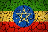 Ethiopia flag on a cracked ground