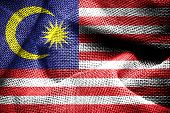 stock photo of sackcloth  - Texture of sackcloth with the image of the Malaysia flag - JPG