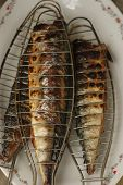 Barbecuing Mackerel On Charcoal Fire Closeup Image.