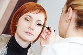 Makeup technique. mascara eyelashes of redheaded woman ?? beauty salon
