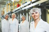 stock photo of manufacturing  - portrait of female pharmaceutical factory worker in pharmacy industry manufacture factory - JPG