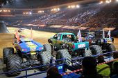 MOSCOW, RUSSIA - MAR 29, 2014: Big jeeps with huge wheels at show Monster X Tour in Olympic Sports Complex