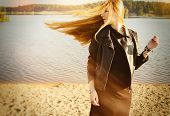 Beautiful Woman Long Red Hair On Wind Near Lake Develop