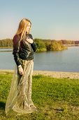 Unusual Gothic Girl With Long Red Hair Reflects At Lake