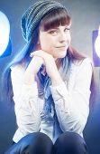Portrait Of Smiling Happy Caucasian Female Wearing Winter Hat In Studio Environment.