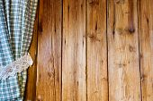 Wooden wall with curtain