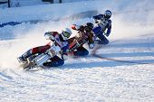 NOVOSIBIRSK, RUSSIA - DECEMBER 20, 2014: Unidentified bikers during the semi-final individual rides of Russian Ice Speedway Championship.