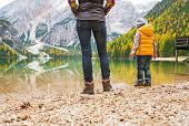 Closeup On Mother And Baby Walking On Lake Braies In South Tyrol, Italy