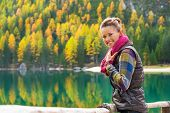 pic of south tyrol  - Portrait of happy young woman on lake braies in south tyrol italy - JPG