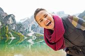 Portrait Of Smiling Young Woman On Lake Braies In South Tyrol, I